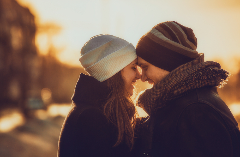 boundaries in marriage - image of happy couple putting their foreheads together during a winter sunset